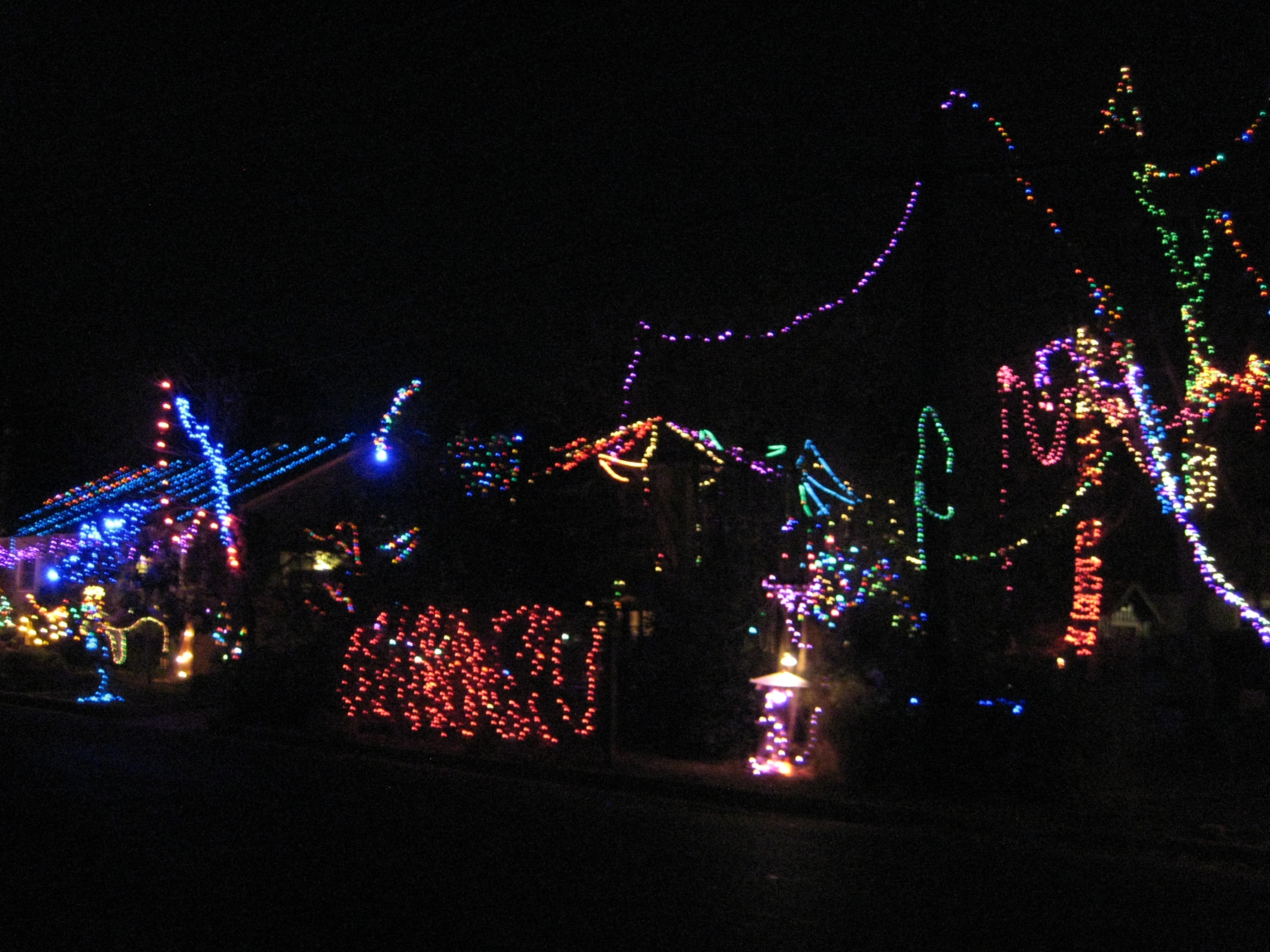 Blur of colorful christmas lights on the corner of 37th street in