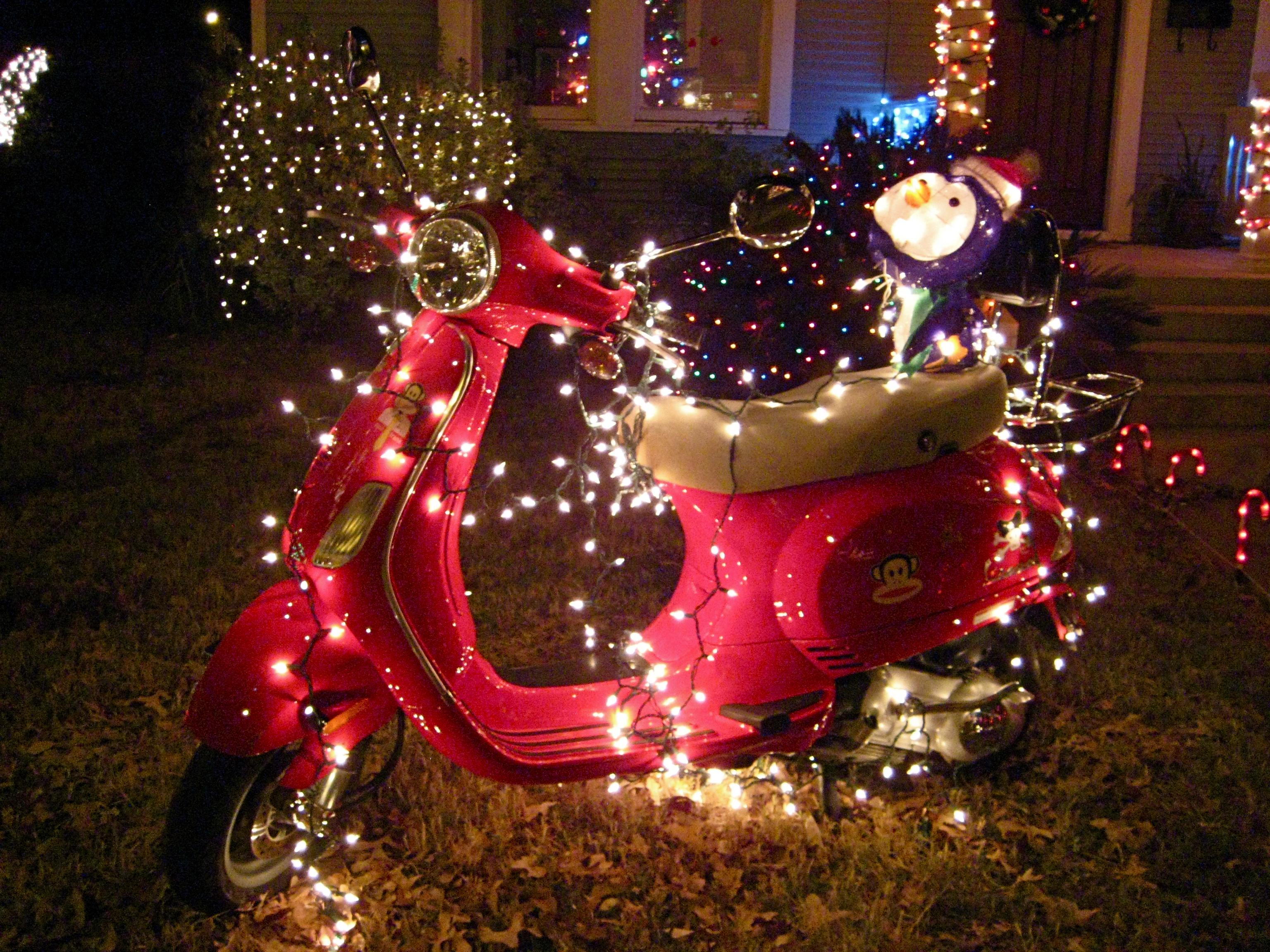 Red Scooter And Xmas Lights