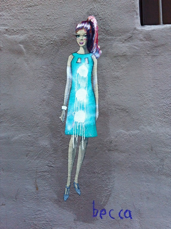 Paint-spattered lady on the side of a building