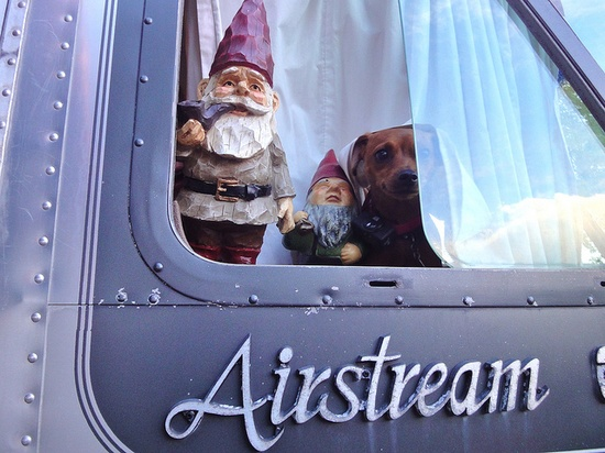 How can this image of gnomes and a wiener dog peering out of a trailer not inspire wanderlust?