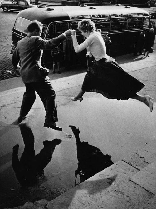 Isn't this gentleman sweet giving a lady a helping hand to leap over a puddle?
